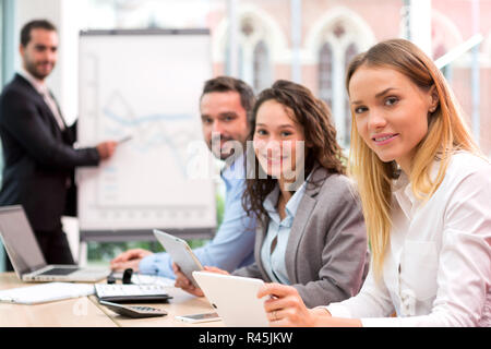 Boss heading a business reunion with partners - Stock Photo