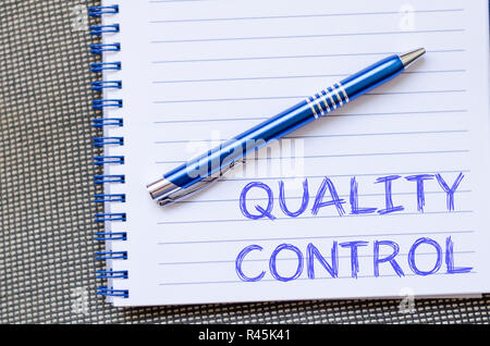 Quality control write on notebook - Stock Photo