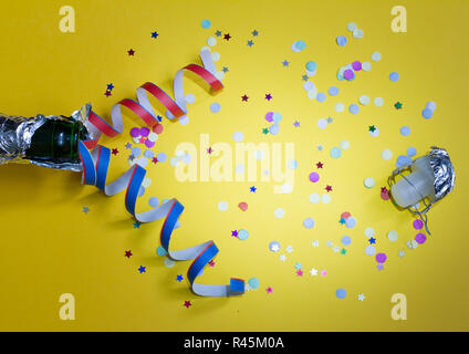 2019 new year party abstract concept with champagne and confetti on yellow background stock photo