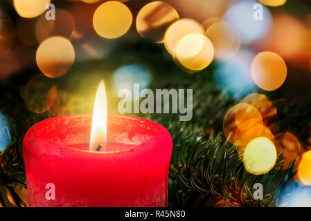 red candle with branch - Stock Photo