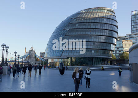 The Scoop by The Queen's Walk, City Hall, London. UK. 22nd October 2018.UK. Tourists relax on the scoop by City Hall October 2018. - Stock Photo
