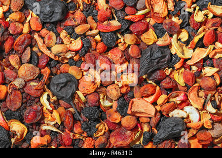 Healthy food. Background of dried fruit. A mixture of dried apricots, pears, raisins, apples, prunes - Stock Photo