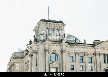 Beautiful view of the Reichstag building on a sunny summer day. One of the attractions of Berlin in Germany and a favorite place to visit tourists. - Stock Photo