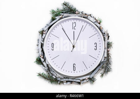 Christmas clock with winter decoration on wall - Stock Photo