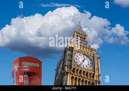British Red Telephone Booth and Big Ben in London.England landmark in front of a blue sky - Stock Photo
