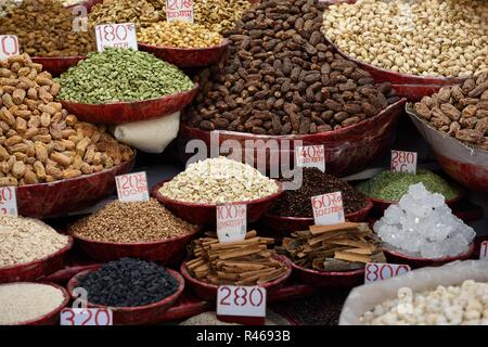 Containers of a variety of fresh dried fruits, nuts and spices in New Delhi, India - Stock Photo