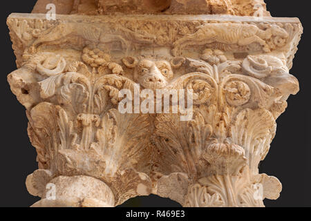 Detail of a stone column, decorated with floral and animal motifs in the cloister of Monreale Cathedral, Sicly, Italy. - Stock Photo