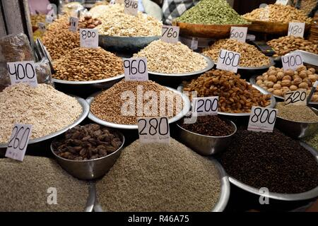 Fresh raw Indian dried fruits, nuts, seeds in the Old Delhi spice market - Stock Photo