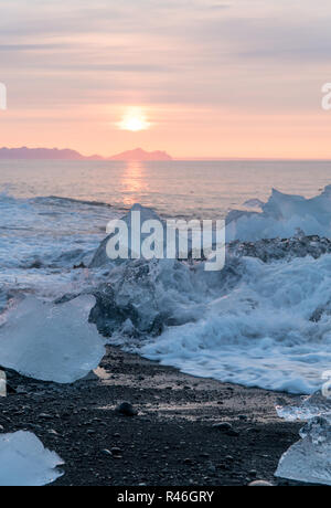 Detail of glacial fragments of ice at Jokulsarlon glacier black diamond beach in south Iceland near Vik during summer time, Iceland - Stock Photo