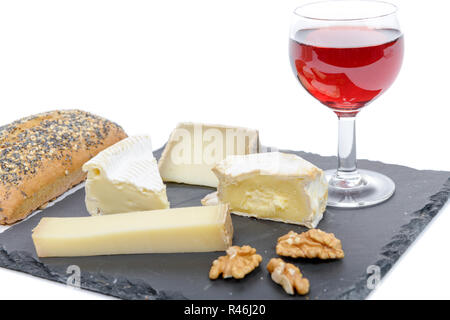 French cheeses on slate with bread and nuts - Stock Photo