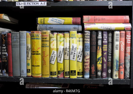 Thriller books from The Saint series written by author Leslie Charteris on sale in Addyman bookshop in Hay on Wye, Wales, UK - Stock Photo