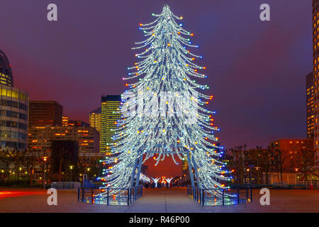 Christmas tree among the skyscrapers in Paris, France. - Stock Photo