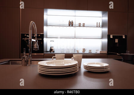 modern high-tech kitchen interior in dark brown tones with a high shiny mixer - Stock Photo