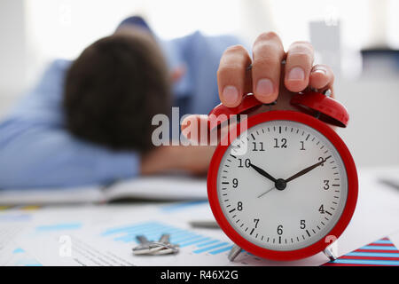 Businessman in blue shirt asleep at work on the - Stock Photo