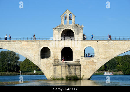Pont d'Avignon or Pont Saint-Bénézet Medieval Bridge over the Rhone River at Avignon Provence France. Chapel of Saint Nicholas in Centre. - Stock Photo