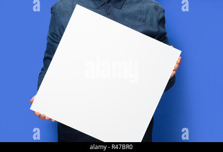 man holding a sign - Stock Photo