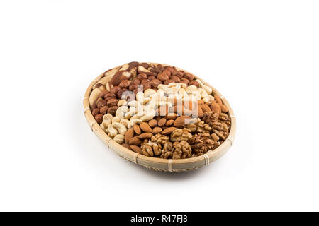Mix nuts in wicker basket - Stock Photo