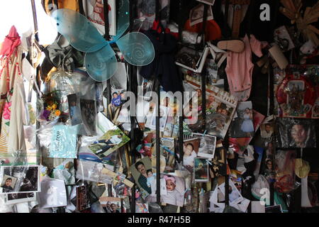 Private belongings, pictures, photos, memories left as a request at Our Lady of Guadalupe Shrine, frequented by Hispanics and immigrants, located in Des Plaines, Illinois. - Stock Photo
