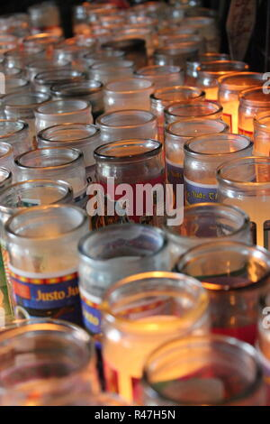Variety of Lit candles at Our Lady of Guadalupe Shrine, frequented by Hispanics and immigrants, located in Des Plaines, Illinois. - Stock Photo