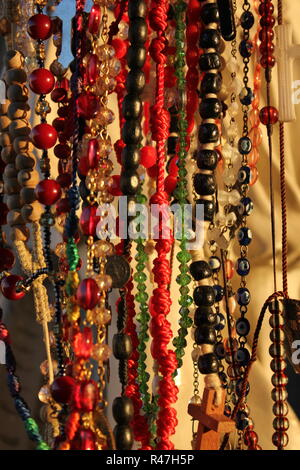 Rosaries hung on a religious status as a request for something at Our Lady of Guadalupe Shrine, frequented by Hispanics and immigrants, located in Des Plaines, Illinois. - Stock Photo