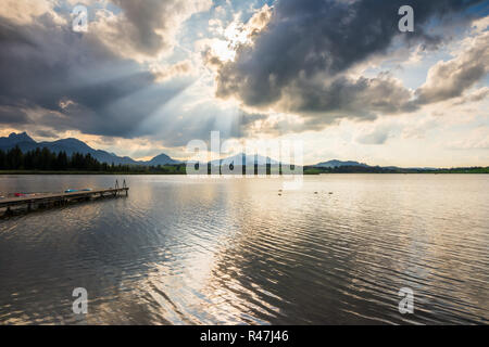 Dramatic sky over Lake Hopfensee - Stock Photo