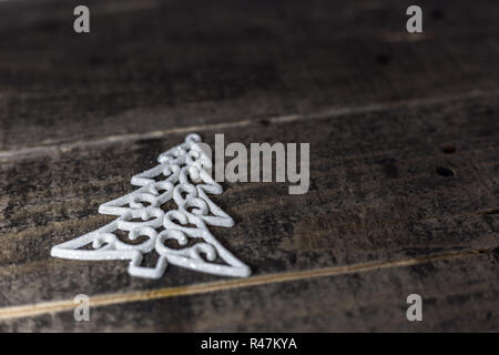 Christmas tree ornament on the old wooden floor. Winter holidays background with empty space for text. - Stock Photo