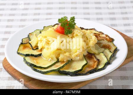 Roasted zucchini with potato egg scramble - Stock Photo