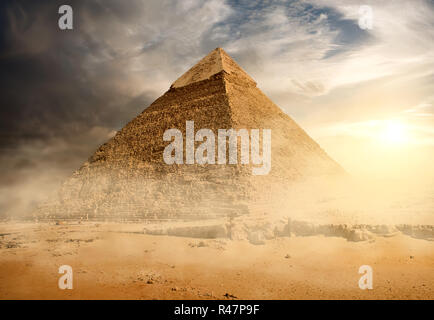 Pyramid in sand dust - Stock Photo