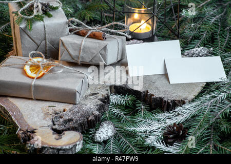 Blank business cards on christmas tree branches, new year decor and gift boxes. - Stock Photo