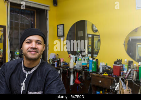 Barber posing in his shop. - Stock Photo