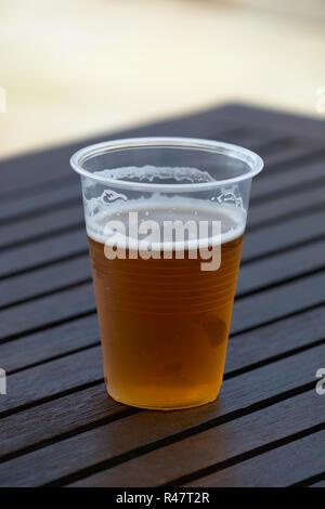 Plastic cup of beer