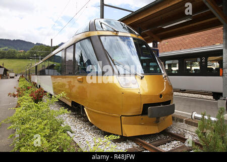 Locomotive at railway station in Zweisimmen. Canton of Bern. Switzerland. - Stock Photo