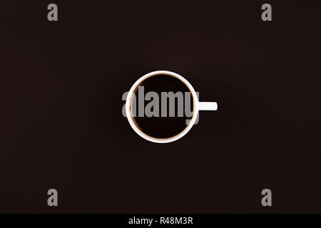 Coffee in a mug with a handle on dark background - Stock Photo