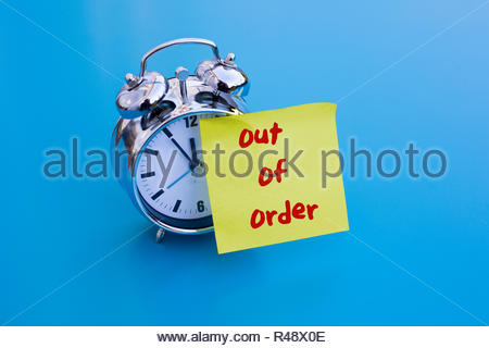 alarm clock with note 'out of order' - Stock Photo