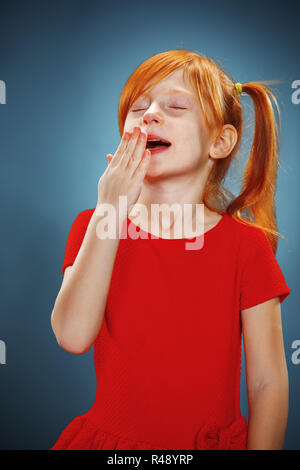 Beautiful portrait of a little yawning girl - Stock Photo