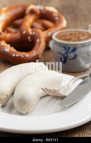 bavarian veal sausage with pretzel - Stock Photo