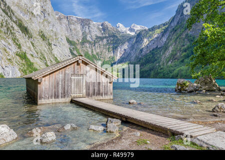 Beautiful view of traditional wooden boat house at the shores of famous Lake Obersee in scenic Nationalpark Berchtesgadener Land on a sunny day in sum - Stock Photo