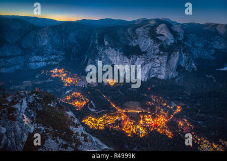 Panoramic aerial bird's eye view of famous Yosemite Valley illuminated in beautiful post sunset twilight during blue hour at dusk in summer, Yosemite  - Stock Photo