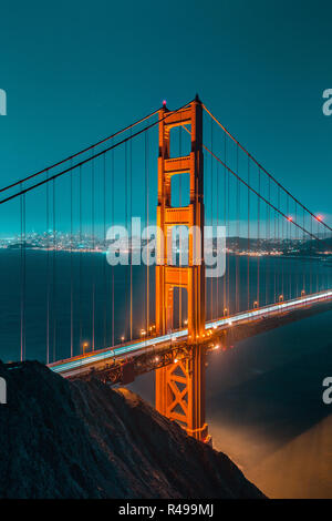 Classic vertical view of famous Golden Gate Bridge seen from Battery Spencer viewpoint in beautiful post sunset twilight during blue hour at dusk in s - Stock Photo