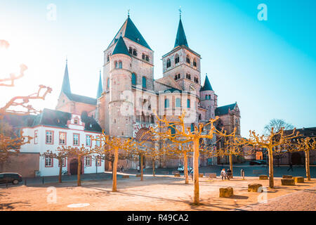 Beautiful view of famous Trierer Dom (High Cathedral of Trier) in beautiful golden morning light in summer, Trier, Germany - Stock Photo