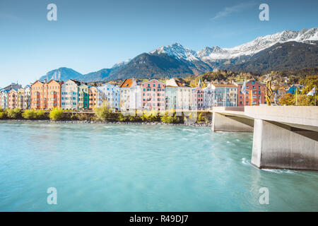 Historic city center of Innsbruck with colorful houses along Inn river and famous Austrian mountain summits in the background, Tyrol, Austria - Stock Photo