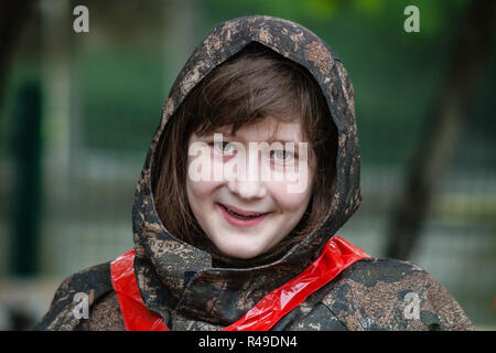 girl in camouflage before paintball game - Stock Photo