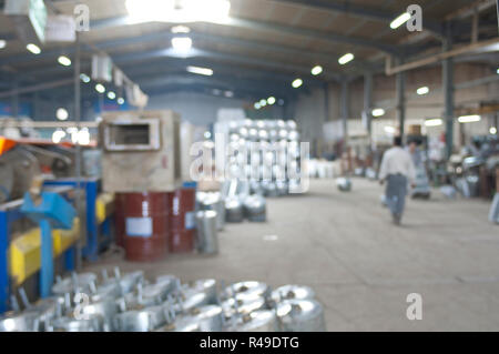 Abstract blurred industrial background image of a water-heaters steel factory interior - Stock Photo