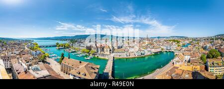 Aerial panoramic view of Zurich city center with famous Fraumunster Church and river Limmat at Lake Zurich from Grossmunster Church, Switzerland - Stock Photo