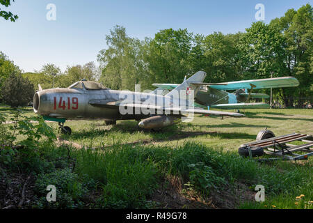1960s soviet russian jet fighter, view of a Warsaw Pact era jet fighter aircraft displayed in a field in the Poznan Museum of Armaments, Poland. - Stock Photo