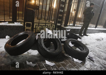 Kiev, Ukraine. 25th Nov, 2018. Soldiers of National guard stand guard next to tires and boats from paper and tries, during a protest of activists, following an incident in the Black Sea near the Crimea annexed by Russia, in which three Ukrainian naval vessels were seized by a Russian border guard vessels, in front of the embassy of Russia in Kiev. Russia's coast guard opened fire on and seized three of Ukraine's vessels on 25 November, wounding two crew members, after a tense standoff in the Black Sea near the Crimea, as local media reported. (Credit Image: © Pavlo Gonchar/SOPA Images via - Stock Photo