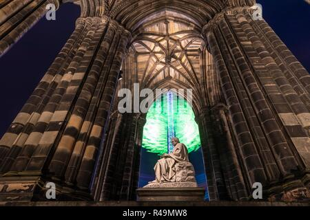 Edinburgh, Scotland, UK. 26th Nov, 2018. The Star Flyer ride in Edinburgh's Princes Street Gardens appears to wrap around the statue of Sir Walter Scott Credit: Rich Dyson/Alamy Live News - Stock Photo