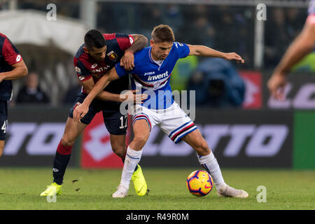 Genoa, Italy. 25th Nov, 2018. Cristian Gabriel Romero (Genoa) Gaston Exequiel Ramirez Pereyra (Sampdoria) during the Italian 'Serie A' match between Genoa 1-1 Sampdoria at Luigi Ferraris Stadium on November 25, 2018 in Genova, Italy. Credit: Maurizio Borsari/AFLO/Alamy Live News - Stock Photo