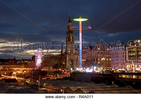 Edinburgh, Scotland, UK. 26 Nov. 2018. Weather, a calm cloudy dusk over Edinburgh city centre with Scott Monument illuminated by Star Flyer and the Big Wheel behind. - Stock Photo