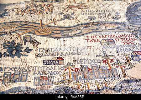 Fragment of ancient floor byzantine mosaic with map of Holy Land on floor of Madaba St George Church, Jordan, Middle East - Stock Photo